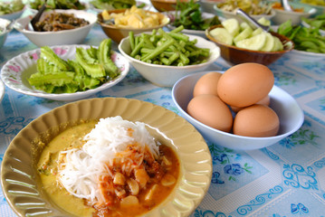 Thai Southern style rice noodle with curry, come along  with many kind of vegetables and boiled eggs, Phang Nga, Thailand