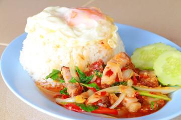 Basil Stir with fried egg, Thailand cuisine style.