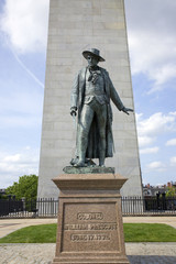 Statue of Colonel Wiliam Prescott stands in front of Bunker Hill Memorial. It stands 221 feet tall at Breed's Hill, the site of the first major battle of the American Revolution, June 17, 1775, Boston, MA