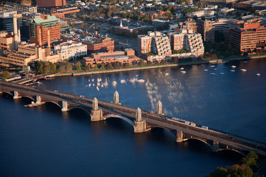 AERIAL morning view of Longfellow Arched Bridge over Charles River to Cambridge, Boston, MA.