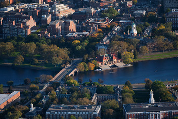 AERIAL VIEW of Cambridge and Anderson Memorial Bridge leading to Weld Boathouse, Harvard on Charles River, Cambridge, Boston, MA.