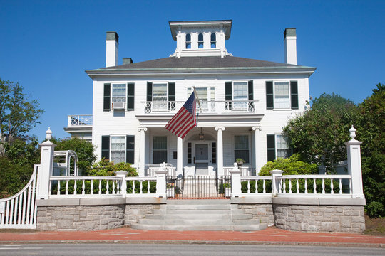 Maine Governors Mansion with US Flag, Augusta, Maine, the state capital of Maine.