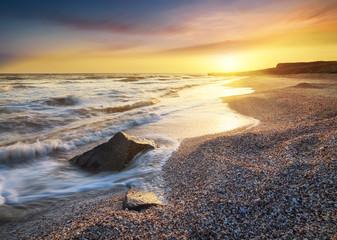 Sea shore during gold sunrise. Beautiful natural seascape