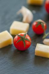 Italian cheese with tomato and garlic