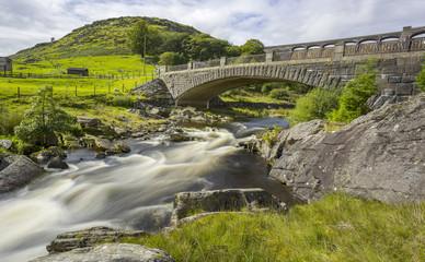 Long exposure of bridge with Claerwen Dam behind, Elan Valley, Wales, UK