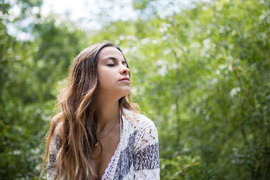 Beautiful young woman with closed eyes
