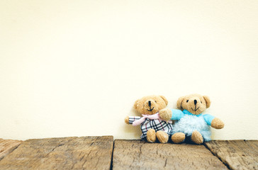 Teddy Bears toy on wood in front concrete background