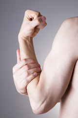 Man with pain in arm. Pain in the human body