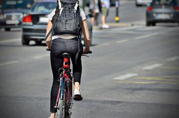 Fototapete - Person on bike in evening traffic
