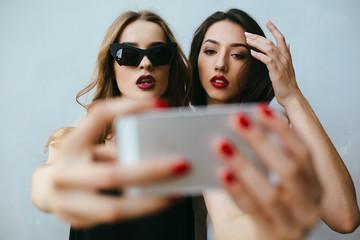 Two girlfriends taking a selfie