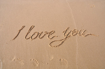 I love you drawing on beach sand