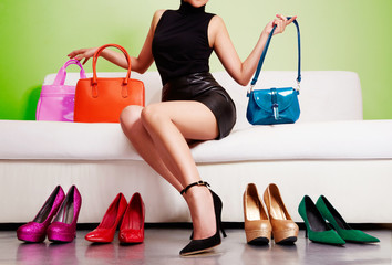 Woman shopping colorful bags and shoes.Beautiful fashion shopping image.