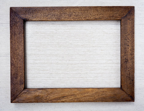 Wooden picture frame on canvas background