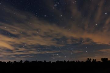 Beautiful night sky, with clouds and constellations, Aquarius, Aguila, Scutum, Ophiuchus, Serpens, Sagittarius, Capricornus