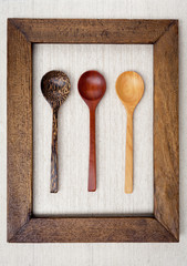 Wooden spoon in wooden picture frame, vintage style
