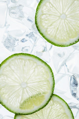green lime slices and ice cubes