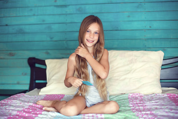 Girl brushing hair in bedroom