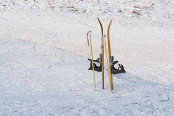 Child's skis stuck in to snow waiting for the master