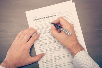 Man filling a job application form
