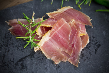 serrano ham with rosemary and peppers