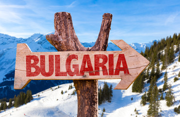 Bulgaria wooden sign with winter background