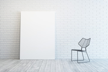 white room with blank picture and chair