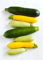Fresh zucchini on the wooden background