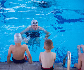 child group  at swimming pool school class