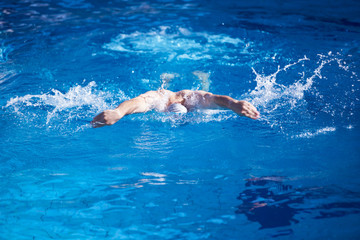 swimmer excercise on indoor swimming poo