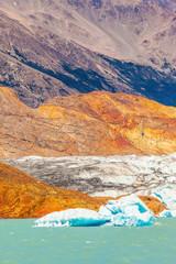 Massive glacier descends into emerald water