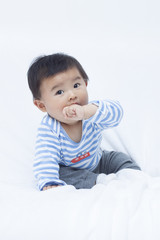 Cute Chinese baby boy in sailor suit