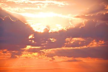 Orange sunset sky with rays of light