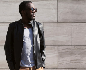 Fashion portrait of stylish young african man wearing a sunglass