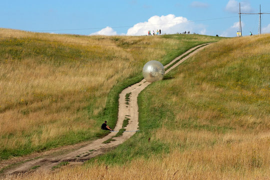 attraction zorbing ball rolling downhill inside an orb