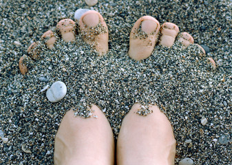 Feet in the pebbles