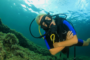 Beautiful blonde woman scuba diving