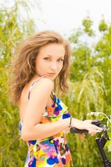 pretty teenage girl with her bike