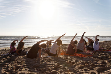 Yoga class by the sea