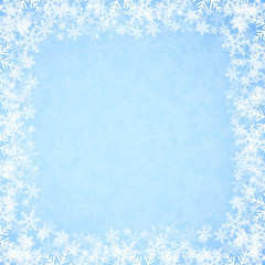 Abstract blue Christmas background with snowflakes.