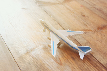 toy airplane over wooden textured table. retro style image