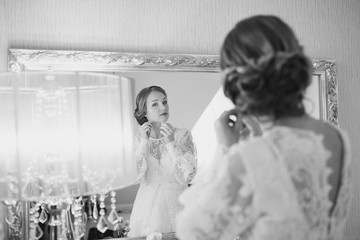Black and white wedding picture of a bride getting ready.