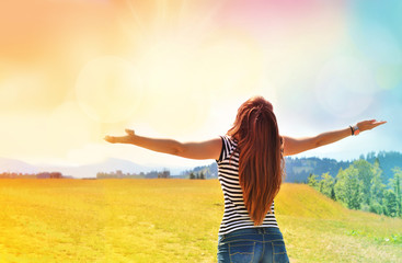 Happy woman enjoying the freedom of happiness. Nature. Sunlight.