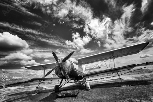 Fotobehang Old airplane on field in black and white