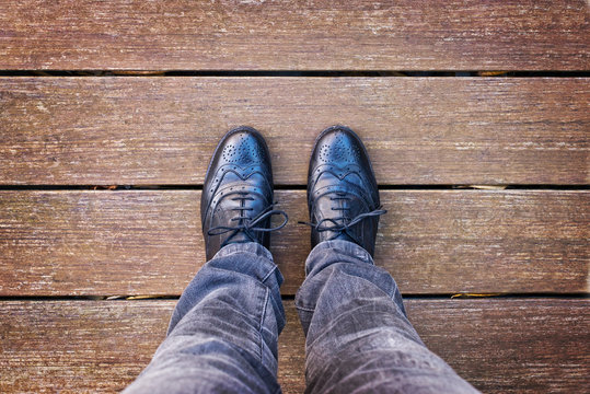 Selfie of foot and legs with black derby shoes seen from above, vintage process