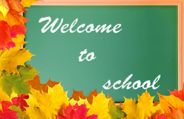 School blackboard with words welcome to school and maple leaves