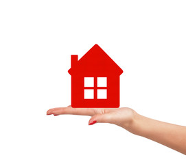 Female hand with small model of house isolated on white