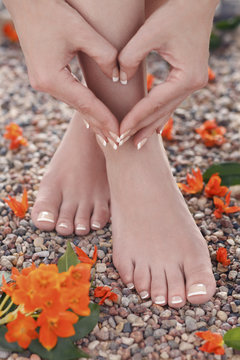 Natural Pedicure and Manicure with Orange Star Flowers in Nature