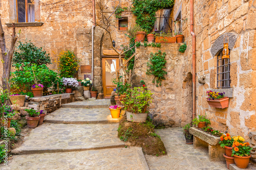 Wall mural Alley in old town Tuscany Italy