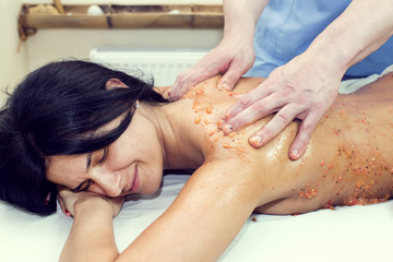 fruity young girl doing a massage in the beauty salon