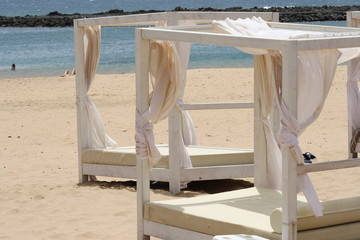 spain, fuerteventura. King size bed with canopy on the beach